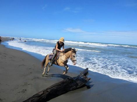 jumping a beach log Playa Grande Cahuita
