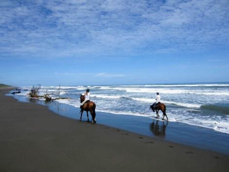 riding along Playa Grande, Cahuita