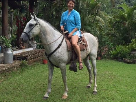 Corinne riding Maximus for the first time by Carlo's Ranch in Turrialba